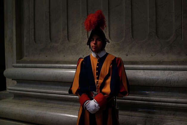 A Swiss Guard stands near the entrance of St Peter's Basilica during the Pro Eligendo Romano Pontifice Mass at St Peter's Basilica, after which Cardinals will enter the conclave to decide who the next pope will be on March 12, 2013 in Vatican City, Vatican. Cardinals are set to enter the conclave to elect a successor to Pope Benedict XVI after he became the first pope in 600 years to resign from the role. The conclave is scheduled to start on March 12 inside the Sistine Chapel and will be attended by 115 cardinals as they vote to select the 266th Pope of the Catholic Church. Photo: Spencer Platt, Getty Images / 2013 Getty Images
