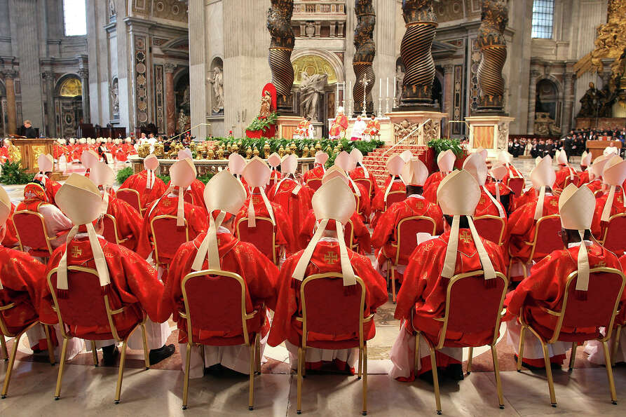 Cardinals attend the Pro Eligendo Romano Pontifice Mass at St Peter's Basilica, before they enter th
