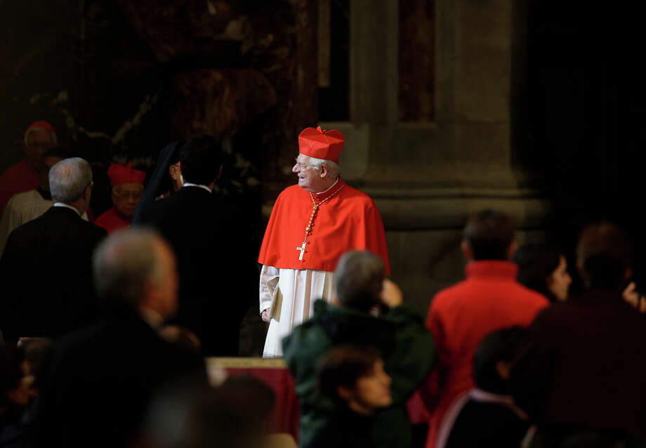 Italian Cardinal Angelo Scola, center, arrives for a Mass for the election of a new pope celebrated by Cardinal Angelo Sodano, not pictured, inside St. Peter's Basilica, at the Vatican, Tuesday, March 12, 2013. Cardinals enter the Sistine Chapel on Tuesday to elect the next pope amid more upheaval and uncertainty than the Catholic Church has seen in decades: There's no front-runner, no indication how long voting will last and no sense that a single man has what it takes to fix the many problems. Photo: Andrew Medichini, AP / AP