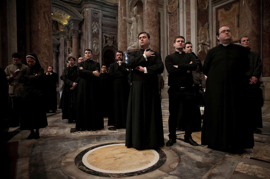 Priests attend a Mass for the election of a new pope inside St. Peter's Basilica at the Vatican on Tuesday, March 12, 2013. Cardinals entered the Sistine Chapel on Tuesday to elect the next pope amid more upheaval and uncertainty than the Catholic Church has seen in decades: There's no front-runner, no indication how long voting will last and no sense that a single man has what it takes to fix the many problems. Photo: Oded Balilty, ASSOCIATED PRESS / AP2013