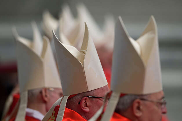 Cardinals attend a Mass for the election of a new pope celebrated by Cardinal Angelo Sodano inside St. Peter's Basilica, at the Vatican, Tuesday, March 12, 2013. Cardinals enter the Sistine Chapel on Tuesday to elect the next pope amid more upheaval and uncertainty than the Catholic Church has seen in decades: There's no front-runner, no indication how long voting will last and no sense that a single man has what it takes to fix the many problems. Photo: Andrew Medichini, ASSOCIATED PRESS / AP2013