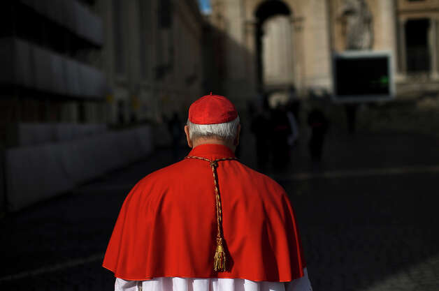 Portuguese Cardinal Jose Saraiva Martins walks in St. Peter's Square on his way to St. Peter's Basilica to attend a Mass for the election of a pope, at the Vatican, Tuesday, March 12, 2013. Cardinals enter the Sistine Chapel on Tuesday to elect the next pope amid more upheaval and uncertainty than the Catholic Church has seen in decades: There's no front-runner, no indication how long voting will last and no sense that a single man has what it takes to fix the many problems. Photo: Emilio Morenatti, ASSOCIATED PRESS / AP2013