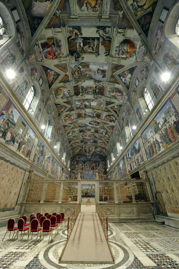 """This handout picture released by Osservatore Romano shows the Sistine Chapel before the arrival of cardinals and the start of the conclave at the Vatican on March 12, 2013. Cardinals moved into the Vatican today as the suspense mounted ahead of a secret papal election with no clear frontrunner to steer the Catholic world through troubled waters after Benedict XVI's historic resignation. The 115 cardinal electors who pick the next leader of 1.2 billion Catholics in a conclave in the Sistine Chapel will live inside the Vatican walls completely cut off from the outside world until they have made their choice. AFP PHOTO/OSSERVATORE ROMANO RESTRICTED TO EDITORIAL USE - MANDATORY CREDIT ?AFP PHOTO/OSSERVATORE ROMANO"""" Photo: -, Getty Images / 2013 AFP"""