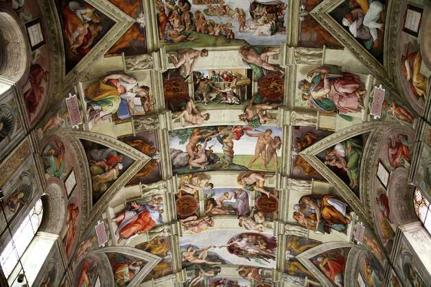 Michelangelo's frescoes on the ceiling and walls of the Sistine Chapel. Photo: Russell Mountford, Getty Images / Lonely Planet Images