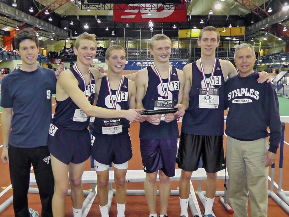 Staples High's 4,000 distance medley relay team finished in first place at the New Balance Indoor National Championships at the Armory in New York on Friday March 8, 2013. The Wreckers recorded a time of 10:07.01, which is both a state and a school record. Pictured (from left to right) are assistant coach Malcolm Watson, Peter Elkind, Jack Scott, Walker Marsh, Henry Wynne and head coach Laddie Lawrence. Photo by Jeff Mitchell, staplesrunning.com. Photo: Contributed Photo