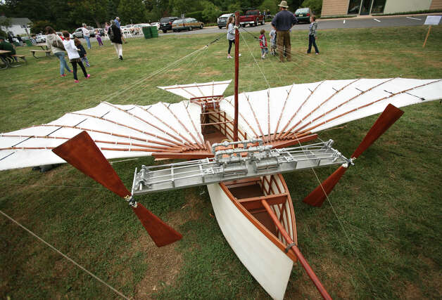 A one half scale model of Gustave Whitehead's Number 21, the plane he reportedly  flew over Fairfield on the morning of August 14, 1901, on display at the Fairfield Museum and Histopry Center's annual Fall Festival on Sunday, September 12, 2010. The flight, which was reported in that week's Bridgeport Sunday Herald, was over two years before the Wright Brothers famous first flight. Photo: Brian A. Pounds, Connecticut Post / Connecticut Post