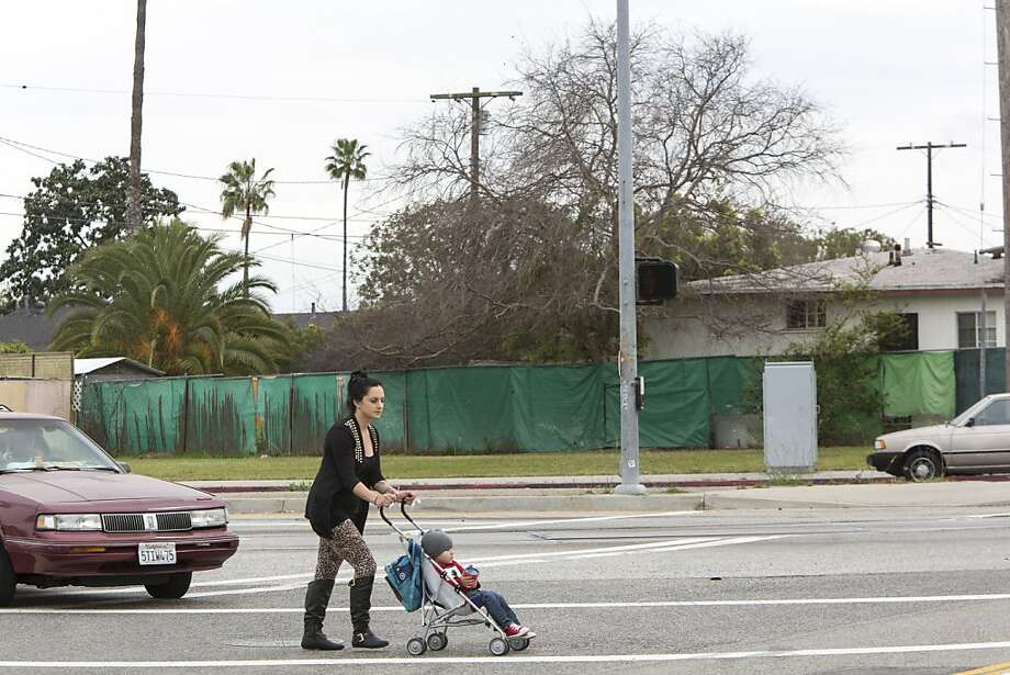 A vacant lot will be turned into a tiny park in the Harbor Gateway area of Los Angeles. Photo: Monica Almeida, New York Times