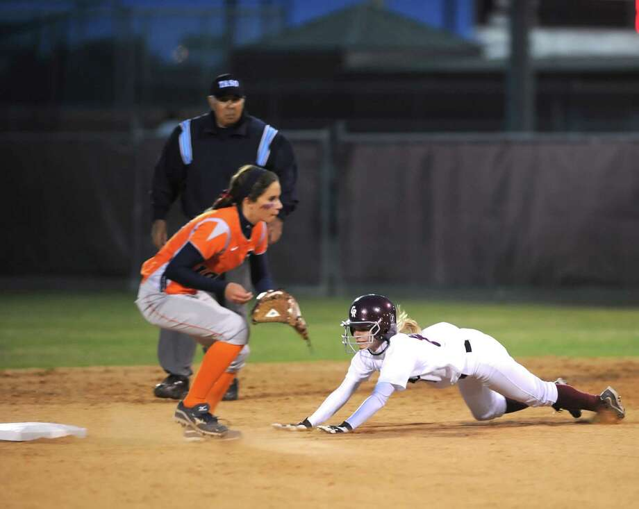 Cinco Ranch's Hannah Esser (8) slides safely into second base as Seven Lakes infielder Kayla Ober, left, waits for the ball. Photo: Eddy Matchette, Freelance / Freelance