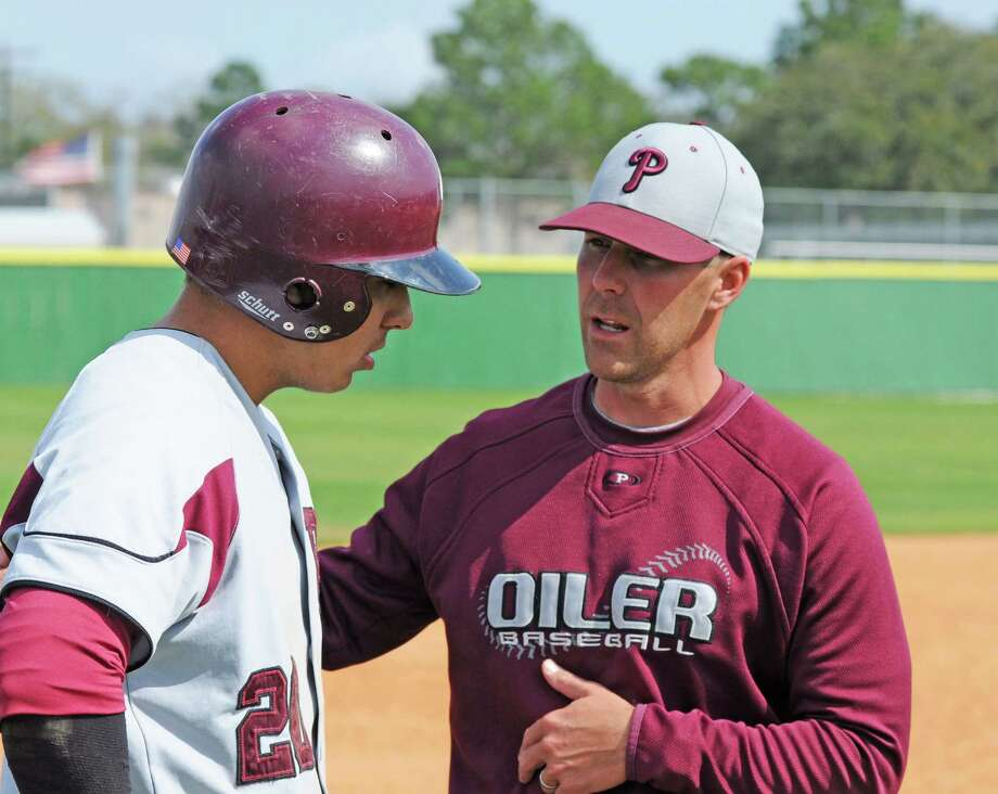 Pearland baseball coach Anthony Scalise (right) with junior Jacob Barfield (20 at right) during a 9-5 win over Mayde Creek at the Alvin ISD Tournament on 3-9-13 at Nolan Ryan Field. Photo: L. Scott Hainline / Freelance