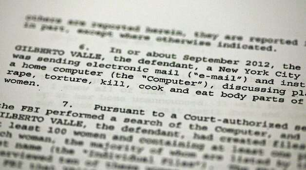 "FILE - This Oct. 25, 2012 file photo shows a passage of a Federal complaint filed in New York, against New York City Police Department officer Gilberto Valle. Valle is accused of kidnapping conspiracy and admits to thinking about abducting, cooking and devouring young women. His own lawyer has shown prospective jurors a kinky staged photo of a woman trussed up in a roasting pan to test their tolerance for the officer's ""weird proclivities."" (AP Photo/Richard Drew, File) Photo: Richard Drew, STF / AP"