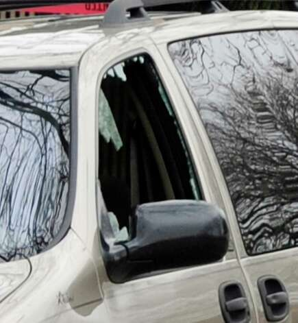 In this Monday, March 11, 2013 photo, a shattered minivan window is seen where 6-month-old Jonylah Watkins, was shot five times while her was changing her diaper in the parked vehicle in Chicago's Woodlawn neighborhood. The Cook County Medical Examiner's office announced Tuesday morning, March 12 that the baby died from her wounds. Her father, Jonathan Watkins, remains in critical condition at Northwestern Memorial Hospital.   CHICAGO LOCALS OUT, MAGS OUT Photo: Chicago Sun-Times, John H. White