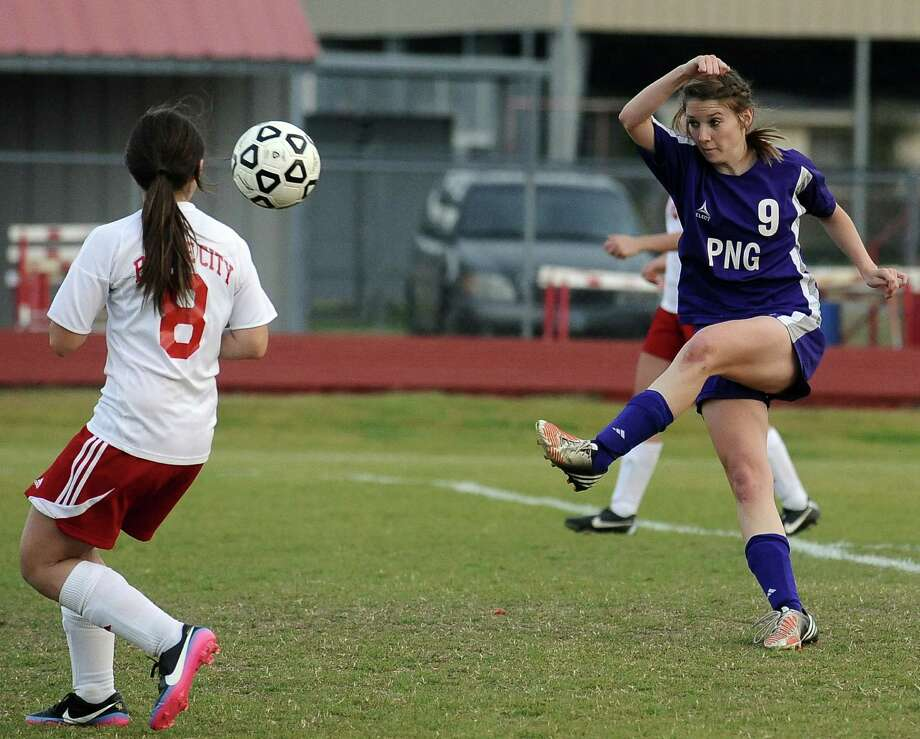 Port Neches-Groves player Jenna Morgan, #9, shots and scores with 7:54 left in the first half during the Bridge City High School 38 - 4A girls soccer game against the Port Neches - Groves High School in Bridge City on Friday, March 8, 2013.  PN-G won 7 - 0. Photo taken: Randy Edwards/The Enterprise Photo: Randy Edwards