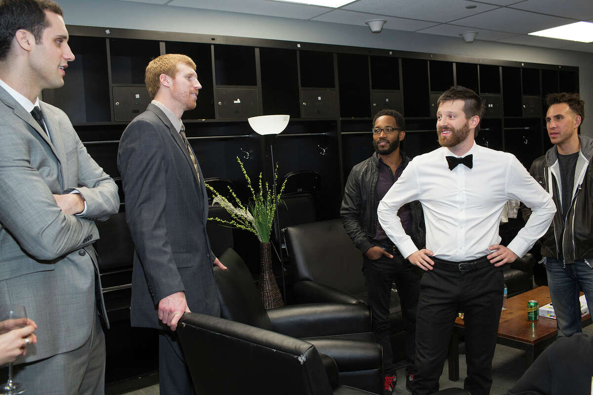 """Spurs Matt """"Red Mamba"""" Bonner, second from left and brother Luke Bonner, left, hang out with musician Mayer Hawthorne, second from right, prior to Hawthorn's performance at the Tux and Tennies Silver and Black Give Back Gala at The AT&T Center, Saturday, March 9, 2013. [NOTE; No ID on the two people on either side of Hawthorn.]"""