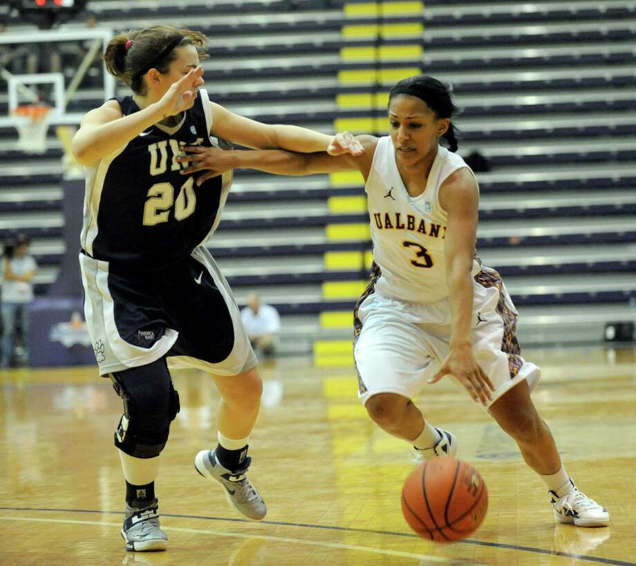 UAlbany's Margarita Rosaio (3) is defended by UNH's Kelsey Hogan (20) during the semifinal game of the America East tournament in Albany, N.Y., Sunday, March 10, 2013. UAlbany won 71-57. (Hans Pennink / Special to the Times Union) College Sports Photo: Hans Pennink, Times Union / Hans Pennink