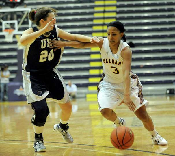 UAlbany's Margarita Rosaio (3) is defended by UNH's Kelsey Hogan (20) during the semifinal game of t