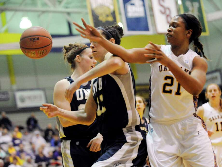 UAlbany's Keyana Williams (21) UNH's Kaylee Kilpatric ( 11) chase a loose ball during the semifinal game of the America East tournament in Albany, N.Y., Sunday, March 10, 2013. UAlbany won 71-57. (Hans Pennink / Special to the Times Union) College Sports Photo: Hans Pennink, Times Union / Hans Pennink