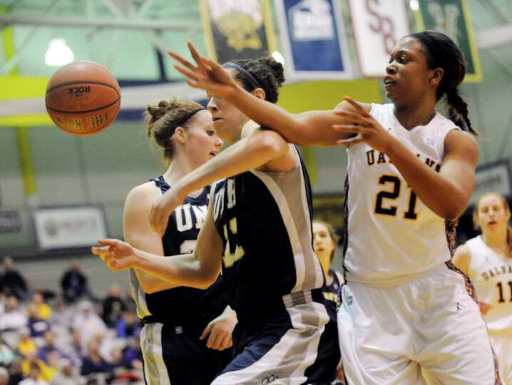 UAlbany's Keyana Williams (21) UNH's Kaylee Kilpatric ( 11) chase a loose ball during the semifinal