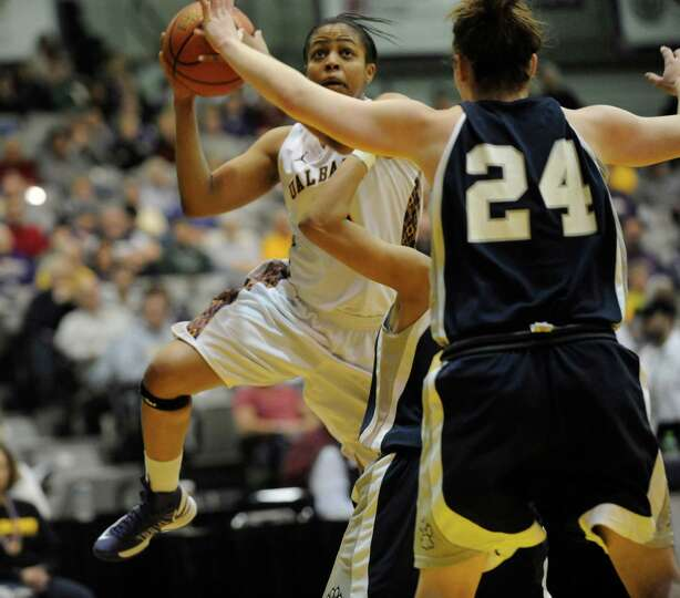 UAlbany's Ebone Henry (5) scores while being defended by UNH's Cari Reed (24) during the semifinal g