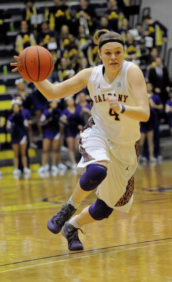 UAlbany's Sarah Royals (4) moves the ball against UNH during the semifinal game of the America East tournament in Albany, N.Y., Sunday, March 10, 2013. UAlbany won 71-57. (Hans Pennink / Special to the Times Union) College Sports Photo: Hans Pennink, Times Union / Hans Pennink