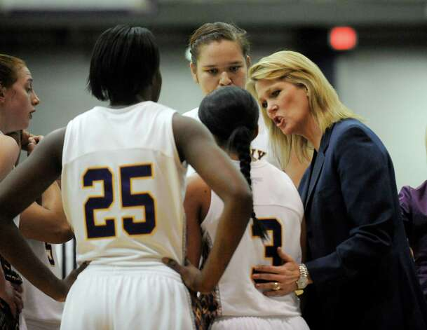 UAlbany Head Coach Katie Abrahamson-Henderson coaches her team against UNH's during the semifinal game of the America East tournament in Albany, N.Y., Sunday, March 10, 2013. UAlbany won 71-57. (Hans Pennink / Special to the Times Union) College Sports Photo: Hans Pennink, Times Union / Hans Pennink