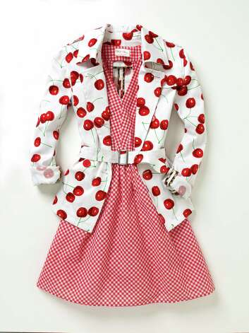 Cherry print belted trench over red gingham dress, Macy's, dress, $59.50; trench, $89.50 Photo: Photo Courtesy Macy's / Macy's