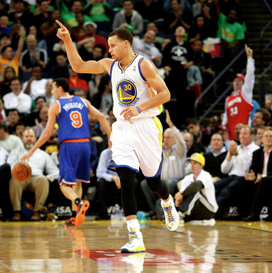Golden State Warriors guard Stephen Curry celebrates after scoring a three-pointer during the third quarter of the game against the New York Knicks on Monday in Oakland. Photo: Beck Diefenbach, Special To The Chronicle / ONLINE_YES