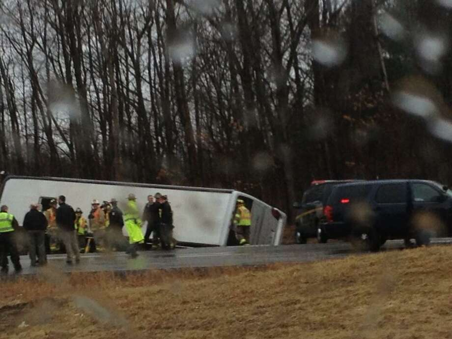 A bus rolled over on March 12, 2013, onto grass next to the overpass near Exit 10 of the Northway. (Bryan Fitzgerald/Times Union)