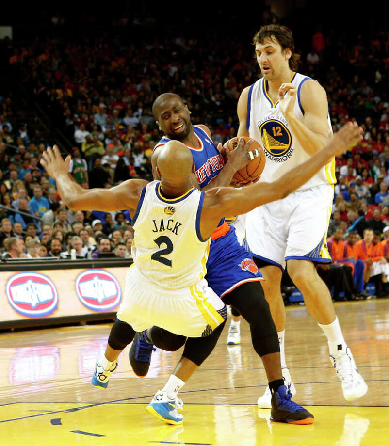 New York Knicks guard Raymond Felton  collides with Golden State Warriors guard Jarrett Jack (2) during the fourth quarter. Photo: Beck Diefenbach, Special To The Chronicle / ONLINE_YES