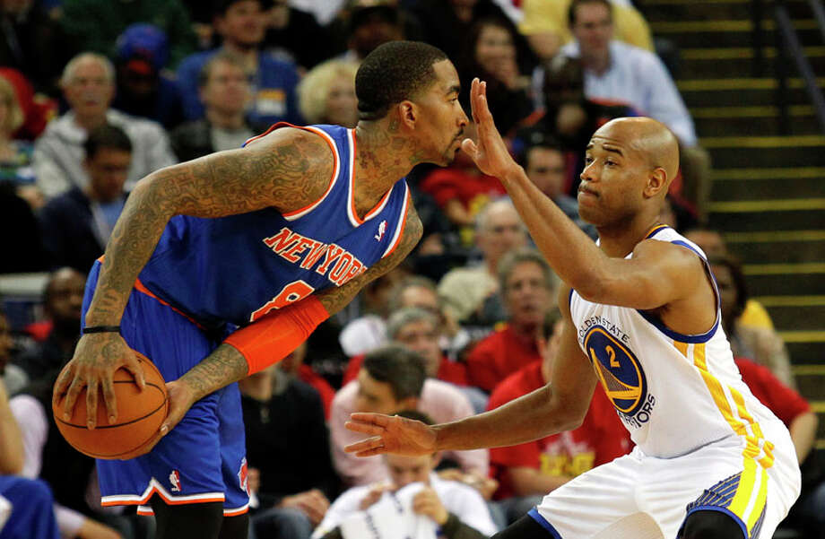 Golden State Warriors guard Jarrett Jack  (2, right) guards New York Knicks guard J.R. Smith (8) during the first half. Photo: Beck Diefenbach, Special To The Chronicle / ONLINE_YES