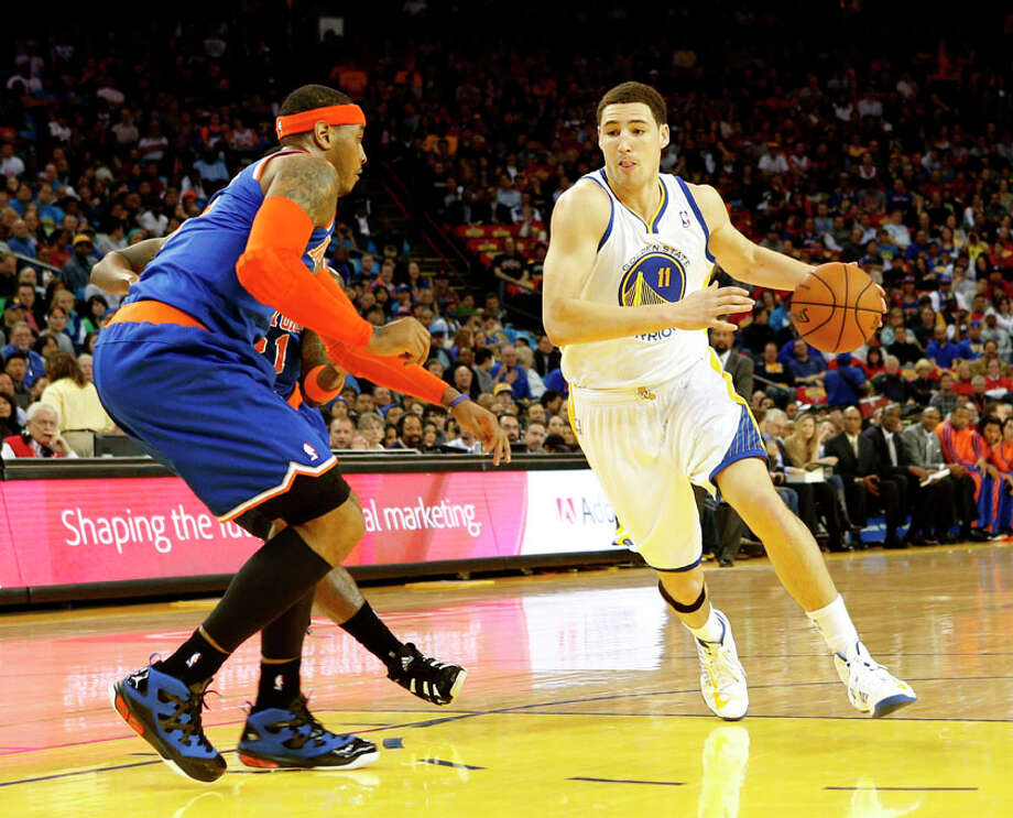 Golden State Warriors guard Klay Thompson (11) dribbles around New York Knicks forward Carmelo Anthony during the first half. Photo: Beck Diefenbach, Special To The Chronicle / ONLINE_YES