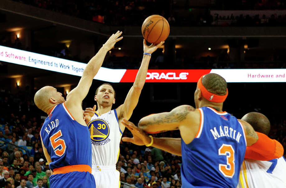 Golden State Warriors guard Stephen Curry shoots the ball over New York Knicks guard Jason Kidd during the first half. Photo: Beck Diefenbach, Special To The Chronicle / ONLINE_YES