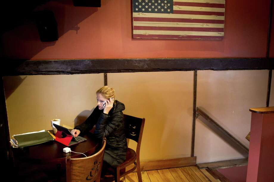 Julianna Conn works from Coffee Barn in Wilton on Tuesday, March 12, 2013. Photo: Lindsay Perry / Stamford Advocate
