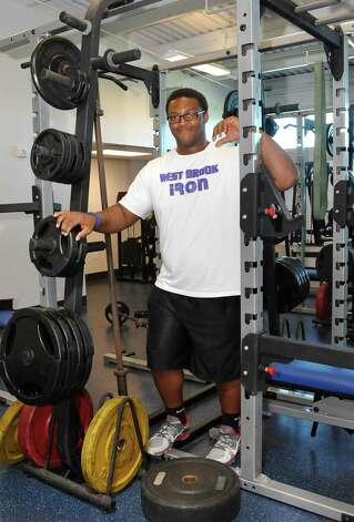 Andrew Bluiett, a junior at West Brook High School, is advancing to state competition in power lifting. He has increased his strength numbers by 430 pounds in two month. He is the only athlete advancing to state.  On Monday morning, March 11, 2013, the first day of Spring Break, he was in the weight room at the new field house working out with his brother Caleb Bluiett, who plays football at the University of Texas. Dave Ryan/The Enterprise Photo: Dave Ryan