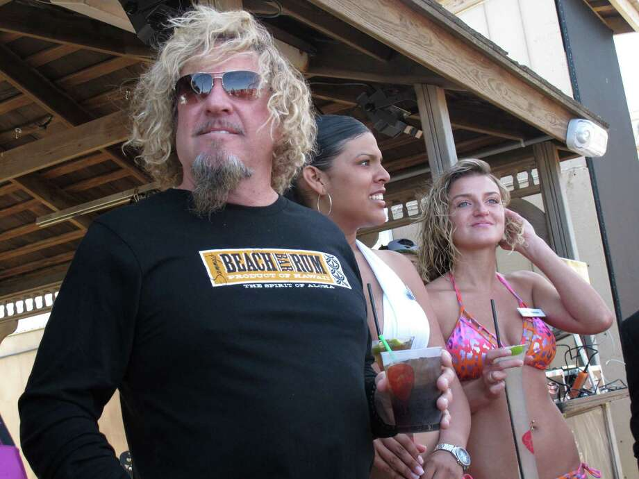 This May 18, 2012 photo shows rocker Sammy Hagar visiting Sammy's Beach Bar, the oceanfront bar he ran with Caesars Entertainment in Atlantic City, N.J. The former Van Halen and current Chickenfoot singer was unable to agree on terms with the company to repair the bar, which was damaged by Superstorm Sandy, and is looking elsewhere this summer. (AP Photo/Wayne Parry) Photo: Wayne Parry