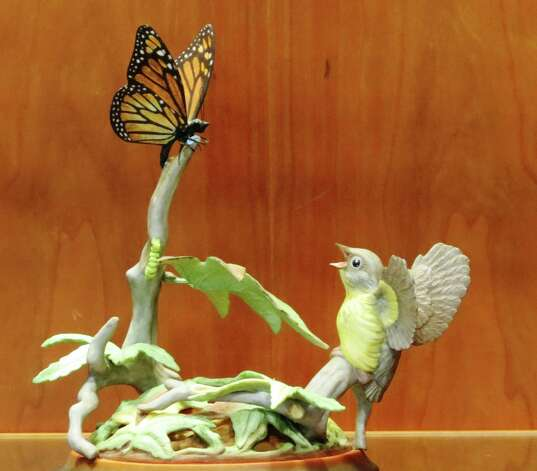 """Fledgling Warbler and Monarch Butterfly"" is among 60 creations by world-renowned sculptor Edward Marshall Boehm that are on view in a new exhibit at the Mark Twain Library in Redding. Photo: Contributed Photo"