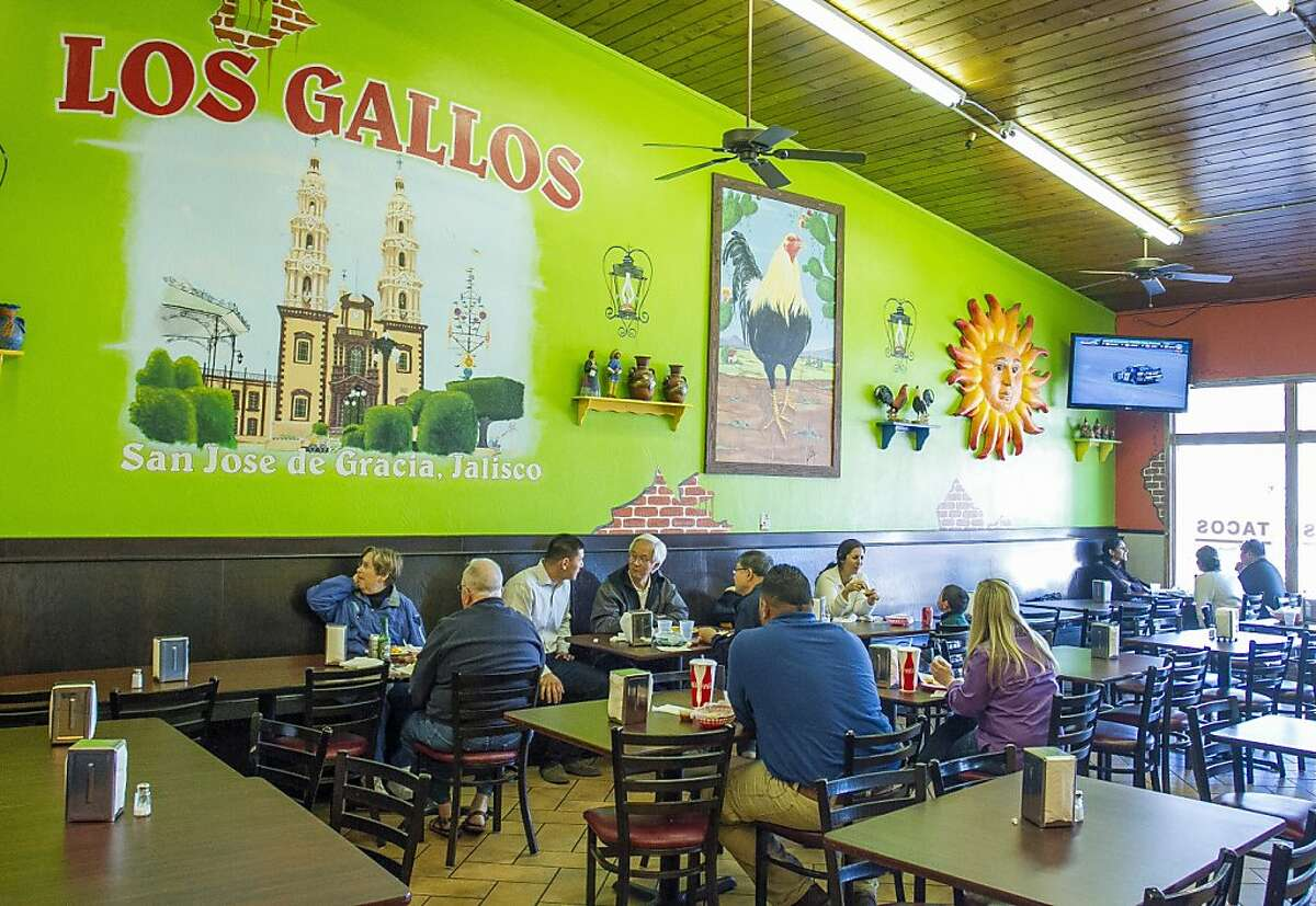 People enjoy lunch at Los Gallos Taqueria in Redwood City, Calif. on Friday, March 1st, 2013.