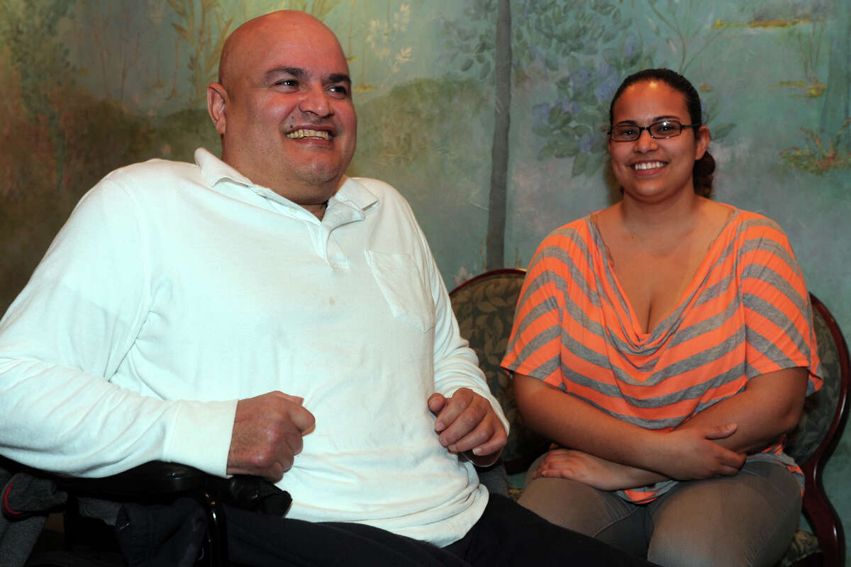 Melvin Gordils and his daughter Irma pose in Ralph âÄònâÄô RicheâÄôs Restaurant, in Bridgeport, Conn., March 12th, 2013 shortly after learning that a jury in Bridgeport Superior Court awarded him $16.2 million in his case against the State of Connecticut. Gordils was struck by a speeding state police cruiser in 2010. He lost a leg in the accident.