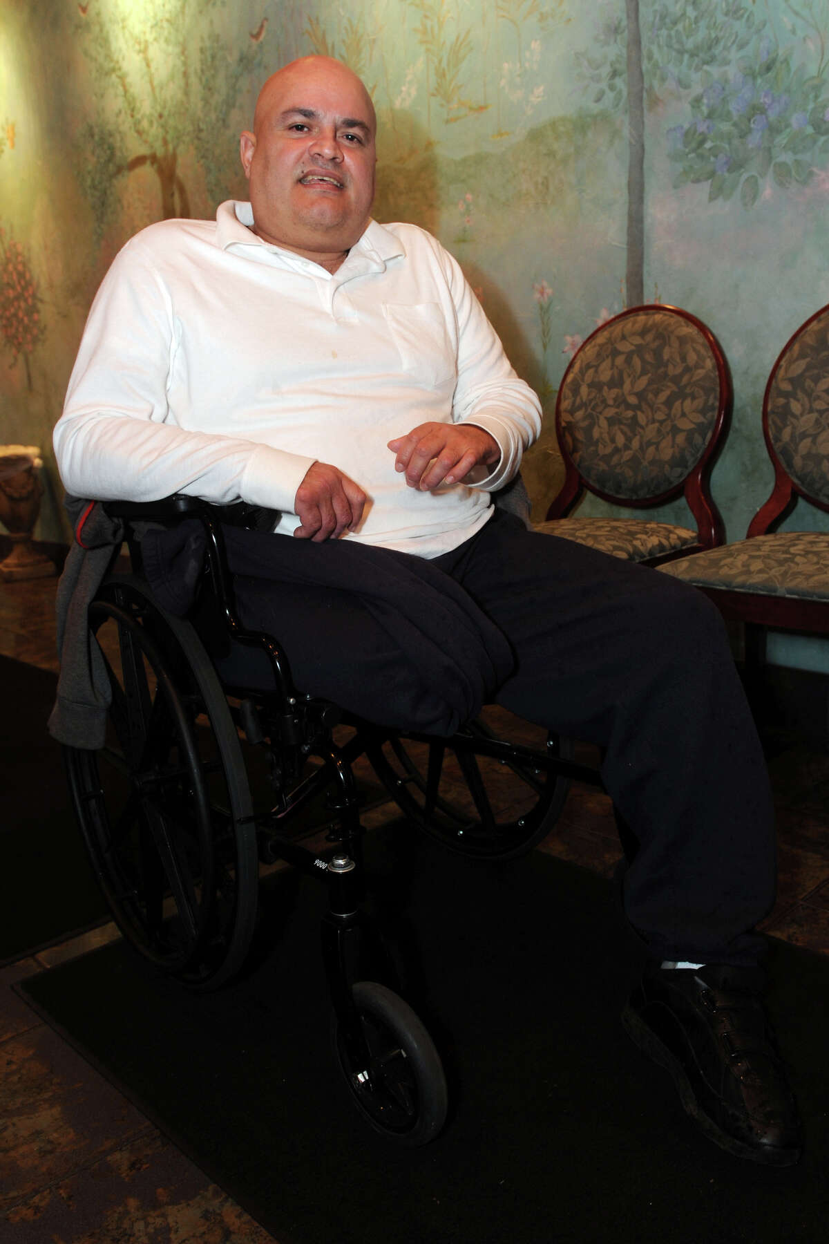 Melvin Gordils poses in Ralph âÄònâÄô RicheâÄôs Restaurant, in Bridgeport, Conn., March 12th, 2013 shortly after learning that a jury in Bridgeport Superior Court awarded him $16.2 million in his case against the State of Connecticut. Gordils was struck by a speeding state police cruiser in 2010. He lost a leg in the accident.