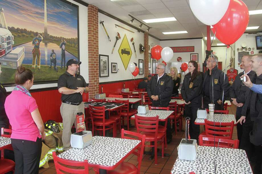 Deer Park Firehouse Subs franchise owner Brad Watkins address firefighters at the restaurant. Firehouse Subs Public Safety Foundation is awarding eight full sets of bunker gear worth more than $20,000 to the Deer Park Volunteer Fire Department. Deer Park Firehouse Subs franchise owner Brad Watkins address firefighters at the restaurant. Firehouse Subs Public Safety Foundation is awarding eight full sets of bunker gear worth more than $20,000 to the Deer Park Volunteer Fire Department. Photo: Pin Lim, Freelance / Copyright Pin Lim.