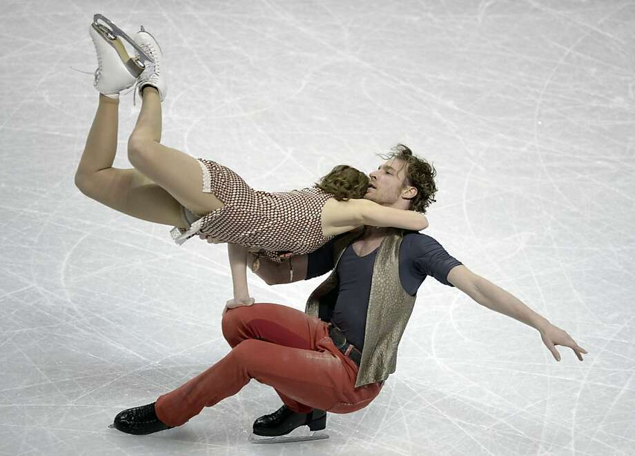 We have to keep meeting like this: Nathalie Pechalat and Fabian Bourzat of France practice at Budweiser Gardens in preparation for the World Figure Skating Championships in London, Ontario. Photo: Brendan Smialowski, AFP/Getty Images