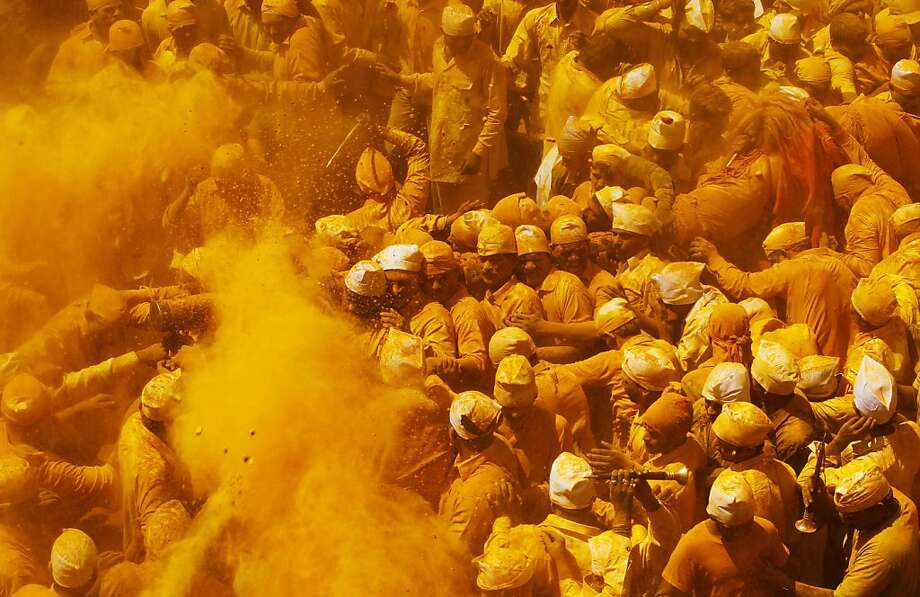 Extra spicy: It wouldn't be Somavati Amavasya, the celebration of the new moon falling on a Monday, at the Jejuri temple without the traditional hurling of turmeric powder. (Pune district, India's Maharashtra state.) Photo: Rajanish Kakade, Associated Press