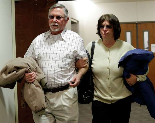 James Holmes parents Robert and Arlene Holmes arrive at district court for the arraignment of  their son Aurora theater shooting suspect James Holmes in Centennial, Colo., on Tuesday, March 12, 2013. The judge has entered a not guilty on behalf of James Holmes after his lawyer said he's not ready to enter a plea. Holmes is charged with killing 12 people and wounding more than 50 in a crowded Colorado movie theater last year. Photo: Ed Andrieski