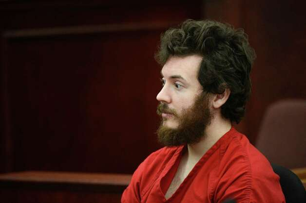 James Holmes, Aurora theater shooting suspect, sits in the courtroom during his arraignment in Centennial, Colo., on Tuesday, March 12, 2013. Judge William Blair Sylvester entered a not guilty plea on behalf of James Holmes on Tuesday after the former graduate student's defense team said he was not ready to enter one. Photo: Denver Post, RJ Sangosti, Pool