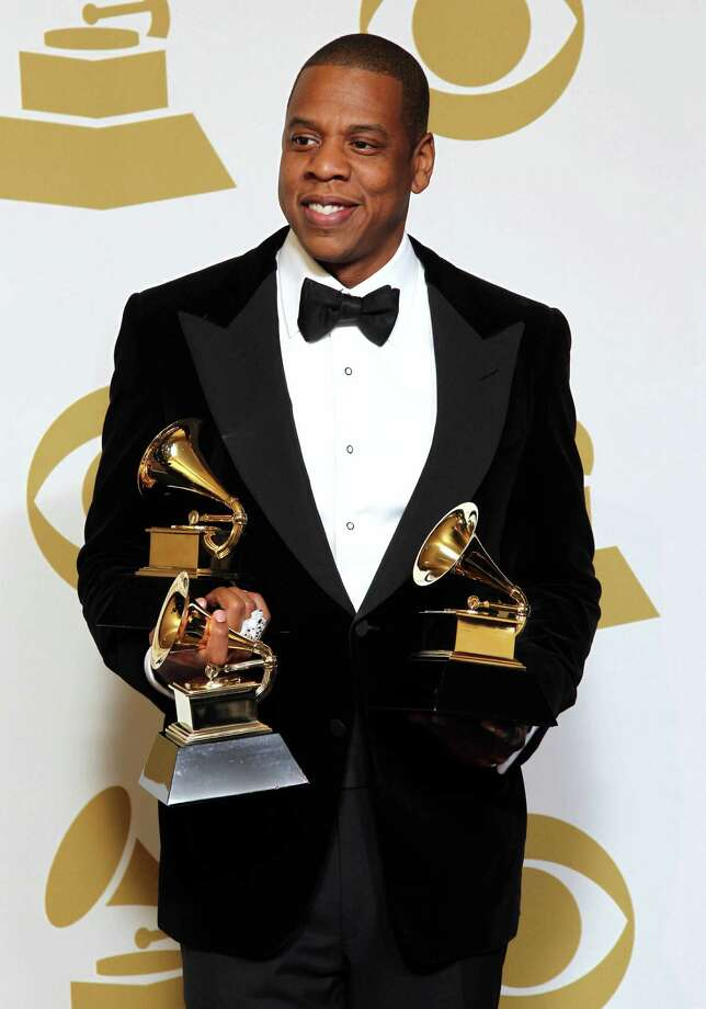"FILE - In this Feb. 10, 2013 file photo, Jay-Z poses backstage with the awards for best rap/sung collaboration for ""No Church in the Wild"" and best rap performance for ""Ns in Paris"" at the 55th annual Grammy Awards, in Los Angeles.  Jay-Z is among 11 celebrities and government officials whose private financial information appears to have been posted online by a site that began garnering attention on Monday, March 11, 2013. (Photo by Matt Sayles/Invision/AP, File) Photo: AP"