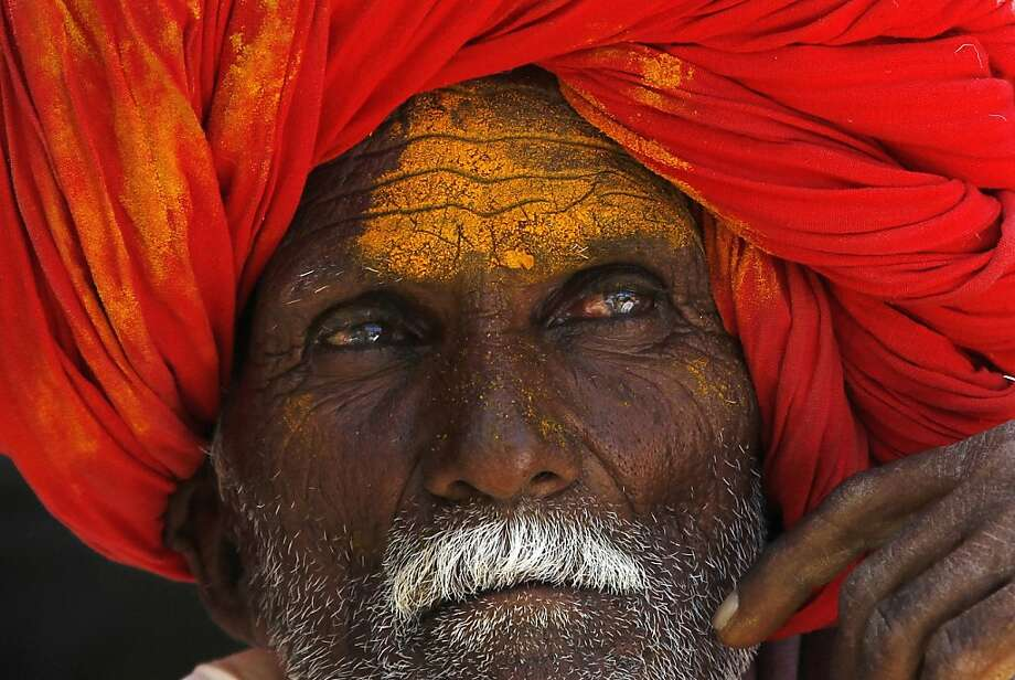 Marking the new moon:A Hindu devotee waits for a procession for the shepherd god Khandoba on Somavati Amavasya at the Jejuri temple in Pune district, India's Maharashtra state. Somavati Amavasya is observed when a new moon falls on a Monday. Photo: Rajanish Kakade, Associated Press