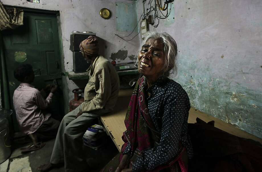 The grieving mother of Ram Singh, the man accused of driving the bus on which a 23-year-old student was gang-raped in December, weeps inside the family's home in New Delhi. Indian police said Singh committed suicide by hanging himself in his cell, but his lawyer and family allege he was murdered. Photo: Manish Swarup, Associated Press