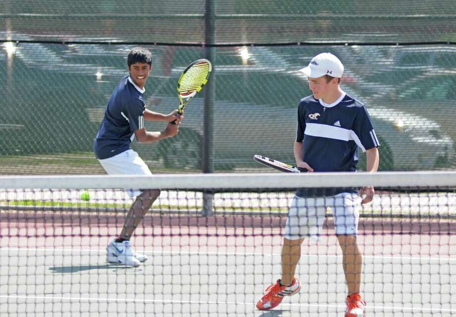 Cy Ranch freshman Alejandro Caviedes, left, and sophomore Christian Borrero took top honors in boys doubles at the 2013 District 17-5A Tennis Tournament last week. Photo: L. Scott Hainline / Freelance