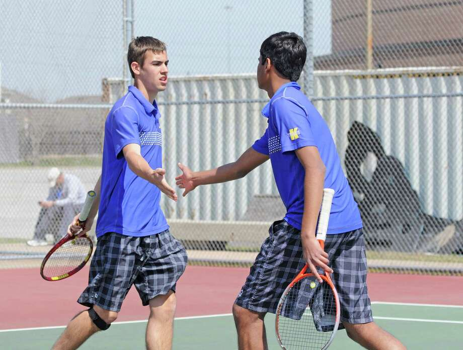 Klein tennis 2013 senior Travis Lenz (left) and junior Raghunath Kadamangudi at the Cy-Fair ISD Tournament on 3-7-13 at Cy Falls High School. Photo: L. Scott Hainline / Freelance