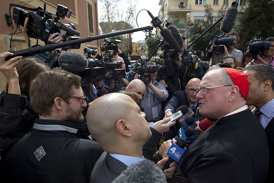 Cardinal Timothy Dolan of New York greets the media Sunday at St. Mary of Guadalupe Church in Rome. Photo: Andrew Medichini, Associated Press