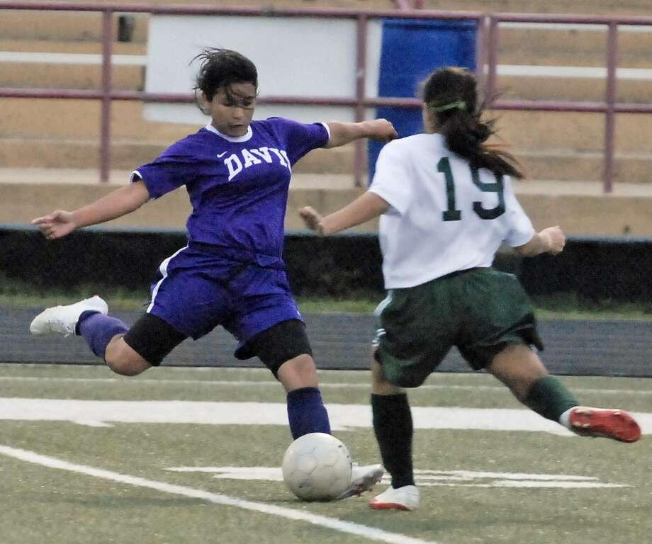 Jessica Jaimes (#8 with Davis) is challenged by Blanca Aguirre (#19 with Sharpstown) during their game Tuesday 2/07/12 at Butler Stadium. Photo by Tony Bullard. Photo: Tony Bullard, Freelance Photographer / Tony Bullard & the Houston Chronicle